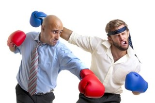 Stock photo of two businessmen boxing, a comical metaphor for an outrageous writing exercise.